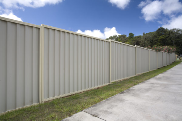 A steel fence in a suburban setting.